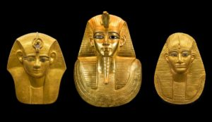 three_egyptian_gold_mummy_masks_of_pharaohs_from_ancient_egypt