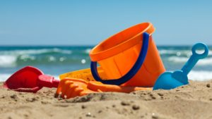 Plastic toys for beach Children's beach toys - buckets, spade and shovel on sand on a sunny day  ID 14934777 © Antartis | Dreamstime